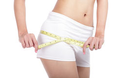 Close up Woman measuring shape of hips Stock Image
