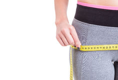 Close-up of woman measuring with tape line Royalty Free Stock Images