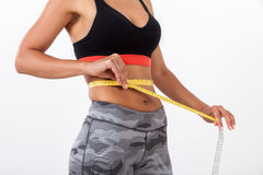 Close up of woman measuring waist Royalty Free Stock Photos