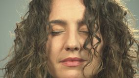 Close-up of woman meditating with closed eyes, awaken opens eyes staring camera stock video