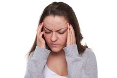 Close-up of woman with migraine. Isolated on white Stock Photo
