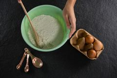 Woman mixing flour in bowl. Close-up of woman mixing flour in bowl Stock Photography