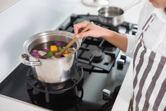 Close up on woman mixing vegetables Stock Photo