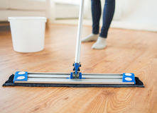 Close up of woman with mop cleaning floor at home Stock Images