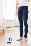 Close up of woman with mop cleaning floor at home Stock Photography