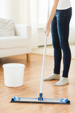 Close up of woman with mop cleaning floor at home Stock Image