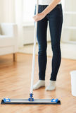 Close up of woman with mop cleaning floor at home Stock Photo