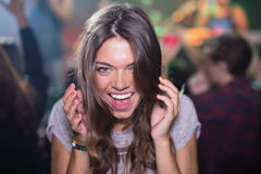 Close-up of woman with mouth open in nightclub Stock Images