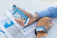 Close up of woman with news web page on smartphone. Business, technology, mass media and people concept - close up of woman hand holding and showing showing news Royalty Free Stock Images