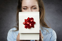 Close up of woman opening present Stock Photos