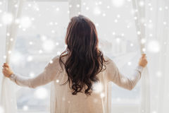 Close up of woman opening window curtains Stock Photography