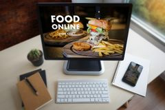 Close up woman ordering food online by internet Concept order. Food stock photo
