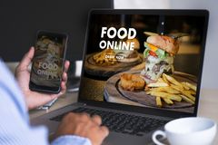 Close up woman ordering food online by internet Concept order. Food stock images