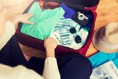 Close up of woman packing travel bag for vacation Stock Images
