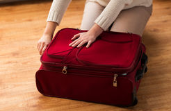 Close up of woman packing travel bag for vacation Royalty Free Stock Photos
