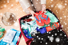Close up of woman packing travel bag for vacation Stock Photography