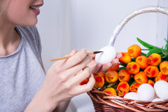 Close up of woman painting Easter eggs Royalty Free Stock Images