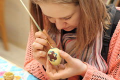 Close up of woman painting Easter eggs Stock Photos