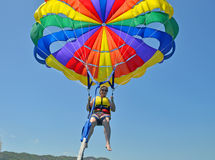 Close up of woman parasailing in clear blue sky Royalty Free Stock Photos