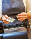 Woman is paying In cash with euro banknotes. Close up on woman is paying In cash with euro banknotes Stock Photo