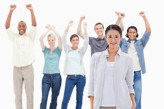 Close-up of a woman with people raising their arms Royalty Free Stock Photos