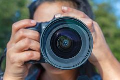 Close up woman photographing with camera Royalty Free Stock Photo