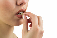 Close-up of woman with pill Royalty Free Stock Photography