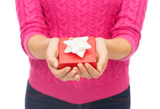 Close up of woman in pink sweater holding gift box Royalty Free Stock Image