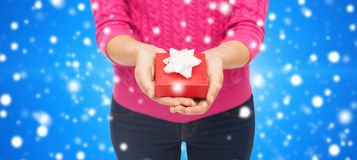 Close up of woman in pink sweater holding gift box Royalty Free Stock Images