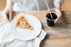Close up of woman with pizza and coca cola drink Royalty Free Stock Photo