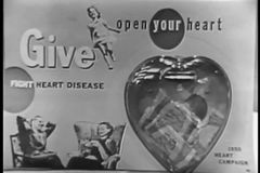 Close-up of woman placing money in plastic heart for heart disease charity stock video