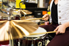 Close up of woman playing cymbals at music store Stock Photography