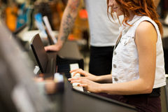Close up of woman playing piano at music store Stock Image