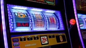 Close up woman playing slot machine stock video