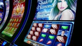 Close up woman playing slot machine stock footage