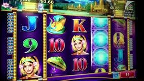 Close up woman playing slot machine Royalty Free Stock Image
