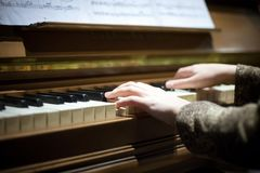 close up woman plays a musical piano. romantic atmosphere. selective focus stock photo
