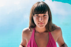 Close-up woman portrait in swim wear standing in blue water Royalty Free Stock Photos