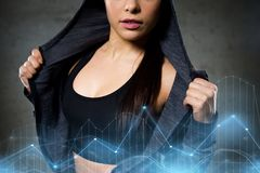 Close up of woman posing and showing sportswear. Sport, fitness, fashion and people concept - close up of woman posing and showing sportswear stock photo
