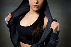 Close up of woman posing and showing sportswear. Sport, fitness, fashion and people concept - close up of woman posing and showing sportswear stock images