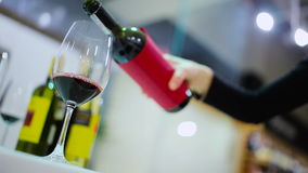 Close-up - woman pouring a red wine in a glass stock video footage