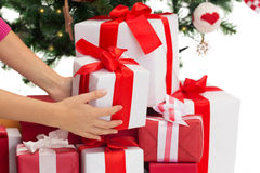 Close up of woman with presents and christmas tree Royalty Free Stock Photo
