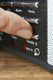 Close Up Of Woman Pressing Standby Button On Radio Stock Photography