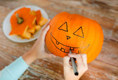 Close up of woman with pumpkins at home Royalty Free Stock Images