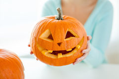 Close up of woman with pumpkins at home Royalty Free Stock Photos