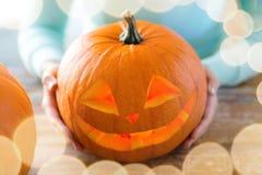 Close up of woman with pumpkins at home Stock Photos