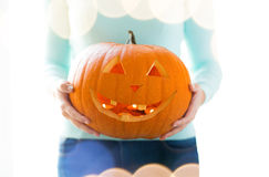 Close up of woman with pumpkins at home Stock Image