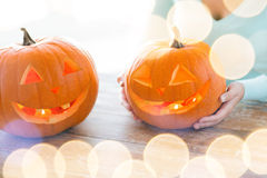 Close up of woman with pumpkins at home Stock Images