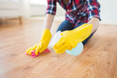 Close up of woman with rag cleaning floor at home Stock Photography