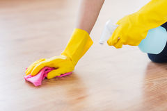 Close up of woman with rag cleaning floor at home Stock Image